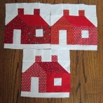 Three red schoolhouses to enter