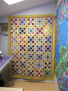 Remi's quilt Top: 9-Patch plaid.