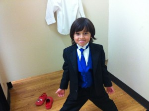 "Here is Remi, maybe the cutest ring bearer ever. His mom said ""I said make a happy face, and he said ""I'm a spy prince and I have to keep the rings safe because they make Katy be married"" then he made this face"""