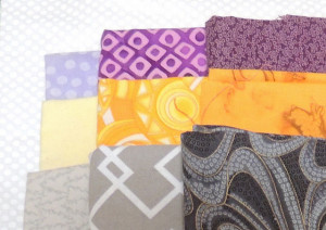 Light, Medium and Dark fabrics in yellow/gold, gray and purple