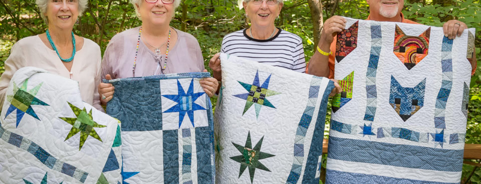 April 2015 Made Fabric Star Blocks into sibling quilts