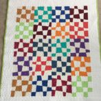 Baby quilt from old blocks