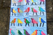 Baby quilt with bird blocks